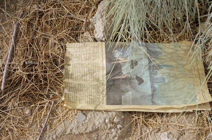 Untitled (Newspaper on ground, grass, California)